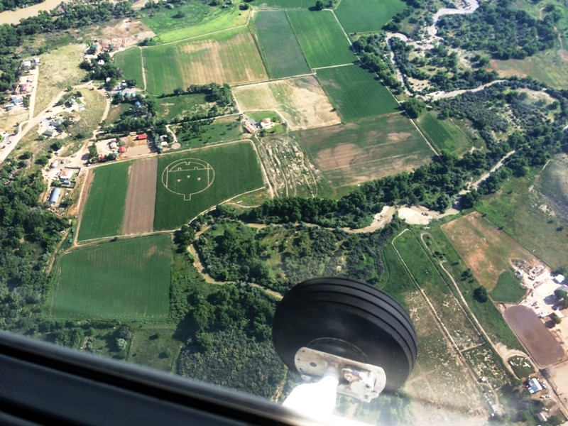 Field from the air with pumpkin carving on Sky Review Aviation