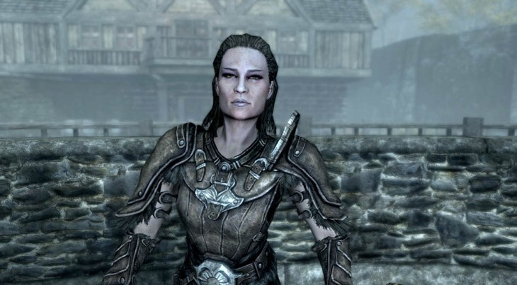 The Blacksmith Grelka standing at her stall in the Riften marketplace in Skyrim.