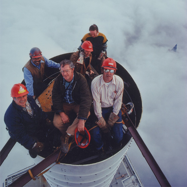 Photograph of the construction crew atop of the antenna of the World Trade Center on a cloudy day. Photograph by Peter B. Kaplan