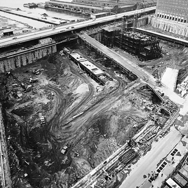 Aerial photograph of the underground site of the World Trade Center almost completely cleared, with ramps connecting the street to underground.