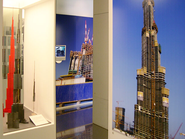 Gallery view of the wind tunnel models and construction photographs of the Burj Khalifa.