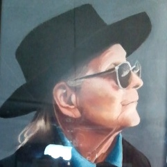Anonymous chalk portrait of Winn Bundy left on her doorstep by a fan.