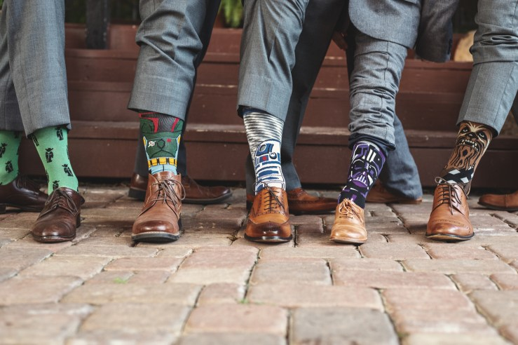 The grooms and groomsmen's colorful socks and personality
