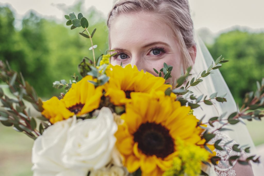 The Bride and her sunflower bouquet at the Red Barn Events in Aubrey Texas