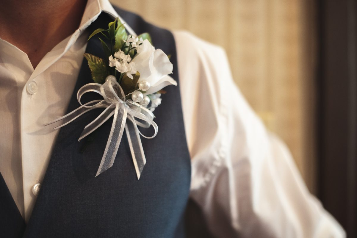 Groom's boutonniere before ceremony | chapel at chestnut square in McKinney, TX | Skys the Limit Production