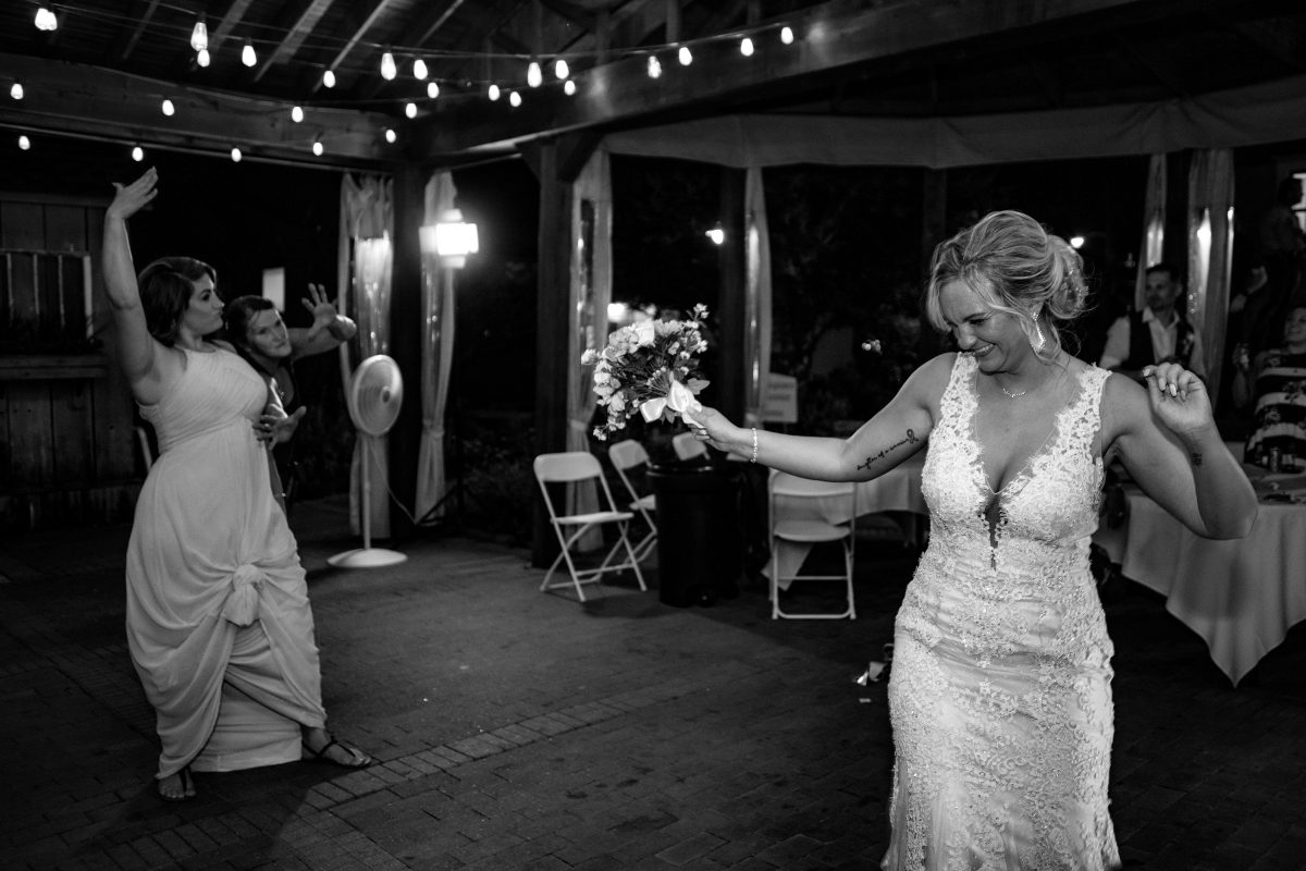 Bride tossing her bouquet | Wedding Reception | chapel at chestnut square in McKinney, TX | Skys the Limit Production