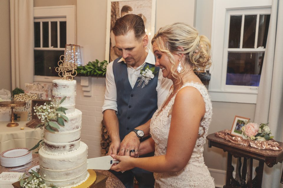 Bride and groom cutting the wedding cake | chapel at chestnut square in McKinney, TX | Skys the Limit Production