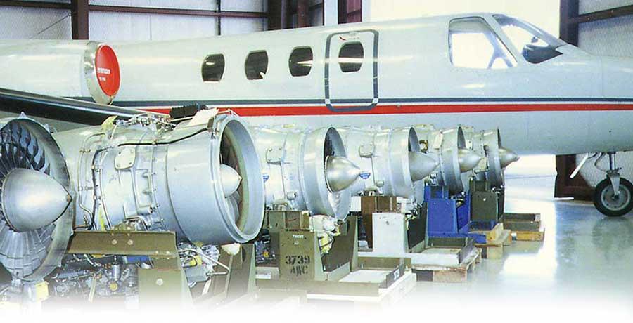 Jet in hangar with jet engines