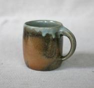 Svend Bayer 79. Mug, wood ash glazed outside with celadon inside, 9.5 x 9 cm £32.50