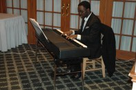 The pianist player for the 8th grade class