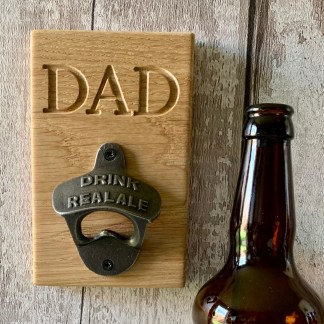 oak bottle opener, solid oak plaque engraved with DAD and fitted with a cast iron beer pull