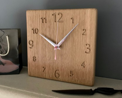 square oak clock with a full face of engraved numbers