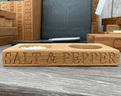 double pinch pot, solid oak block with two recesses one for salt one for pepper, engraved with salt & pepper along the front edge