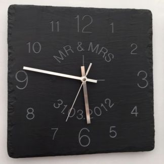 square welsh grey slate clock with engraved numbers around the face and personalised text in the middle of the clock engraved in a circle format