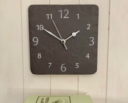 slateandoak square welsh heather slate clock, with visible surface graining, engraved with a full face of numbers