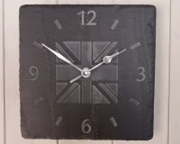 square welsh grey slate clock with a full face of numbers and an image of a union jack engraved in the middle