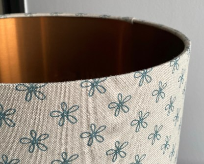 daisy design drum lamp shade with a brushed copper lining