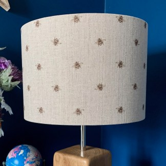 drum lampshade in natural linen fabric digitally printed with a sepia coloured bee print image arranged in a step repeat patter