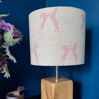 drum lampshade in natural linen fabric digitally printed with a pair of boxing hares in a sugar pink colour