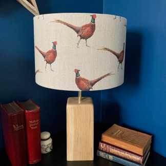 drum lampshade in natural linen fabric printed with a colourful pheasant