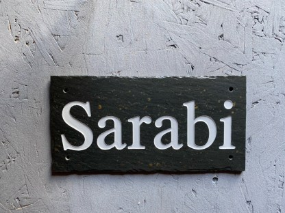 engraved slate stable sign with the text sarabi