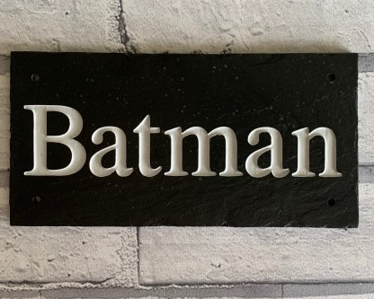 engraved slate stable sign with one line of text and a mix of upper and lower case characters