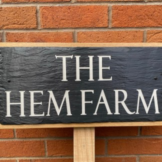 engraved slate house sign mounted on a solid oak back board designed for mounting on a post or a wall