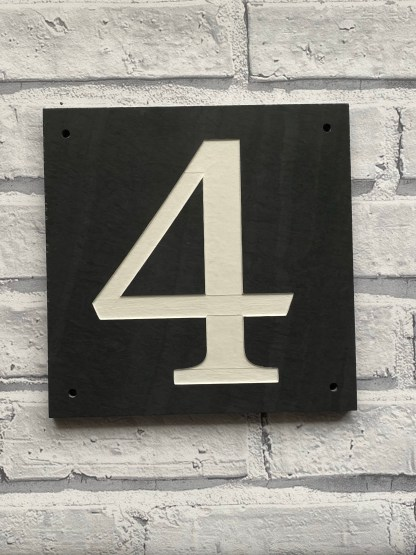 20cm square welsh grey thick honed slate house sign, engraved with a number 4 and painted in off white and finished with a matt sealer