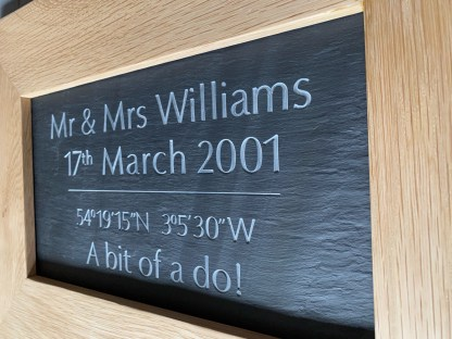 side view of an oak framed slate showing the close up of the engraving on the slate