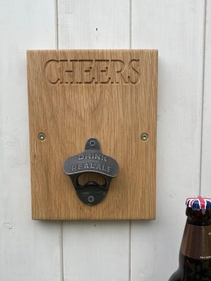 oak plaque with cast iron bottle opener