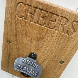 oak plaque fitted with cast iron bottle opener, oak engraved with cheers