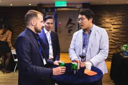 Slator Co-Founder Florian Faes (left) interacts with SlatorMeet Hong Kong 2018 guests