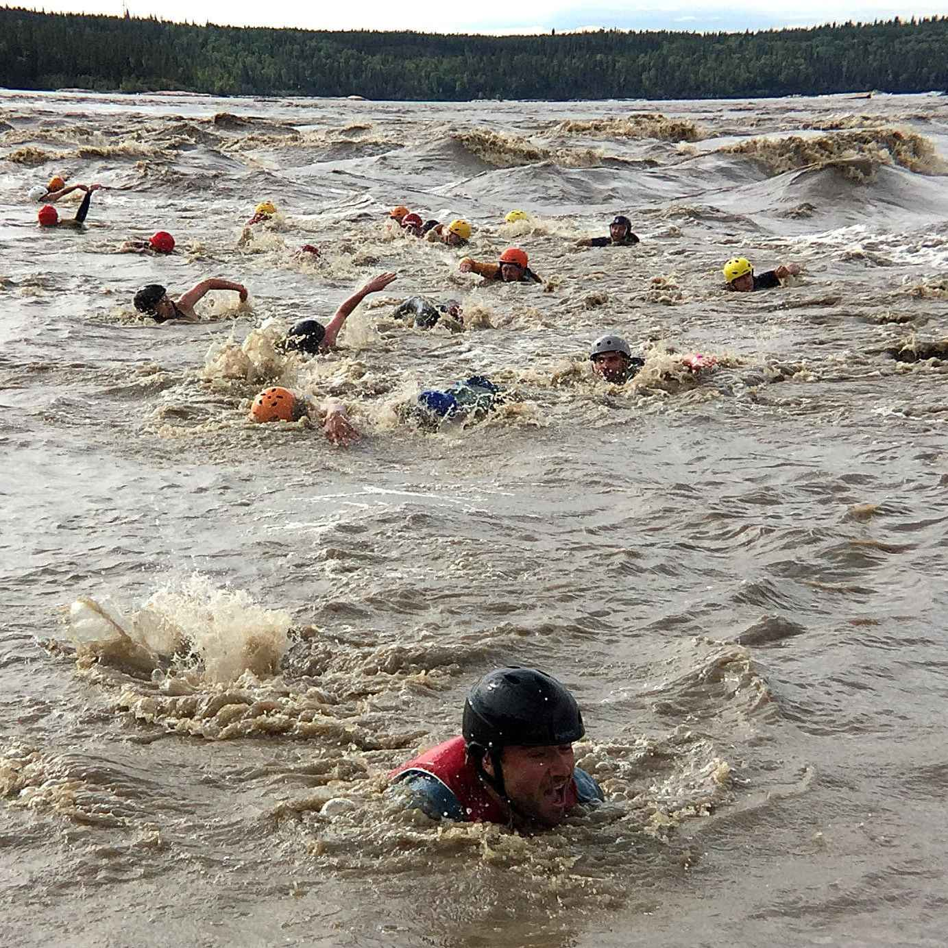 Swimmers compete to get through rapids.