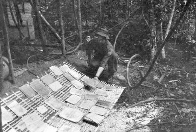 Australian Lance Corporal Barry O'Brien Drying Captured Viet Cong Documents