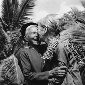 Elders From North and South Vietnam Embrace After the War