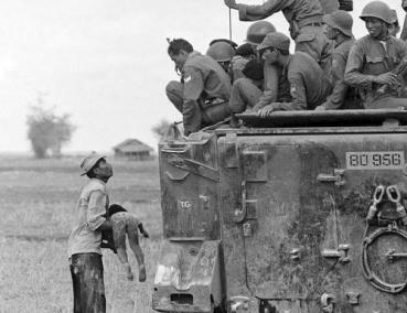 Father Holds the Body of His Child as South Vietnamese Army Rangers Look Down From their Armored Vehicle