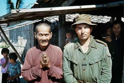 Local Villagers Surround Lieutenant John Lucaci and a Vietnamese Monk