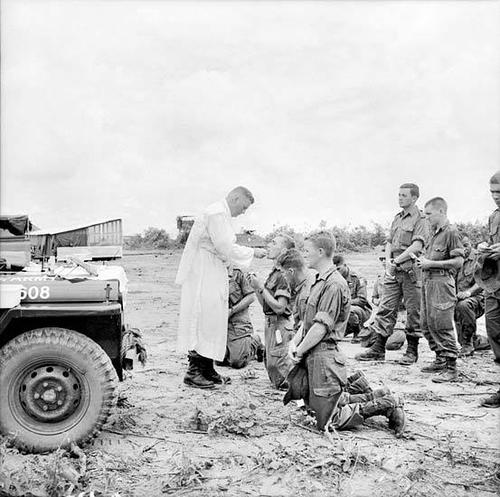 Roman Catholic Chaplain With 1RAR Gives Communion - Remembering The Vietnam War