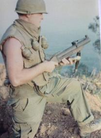 Soldier With A M79 Grenade Launcher And Grenades