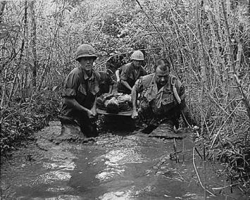 Soldiers Carry a Wounded Friend Through a Canal