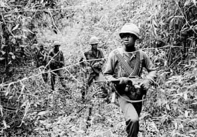 U.S. Soldiers Searching for Viet Cong Hideouts in Swampy Jungle Creek Bed