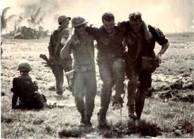 Wounded Soldier is Assisted by His Comrades