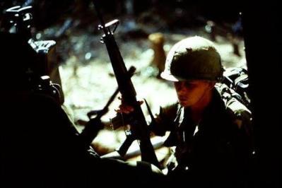 unidentified soldier with his machine gun