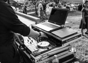 dj mixing music on controller in back yard in utah county
