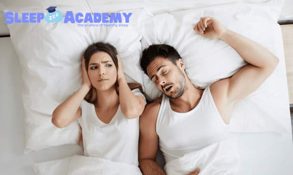 Couple in bed snoring - Sleep Academy