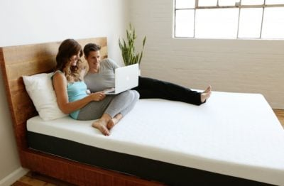 Sleep Delivered  The Best Online Mattresses Reviewed and Compared Best mattress reviews   couple on bed