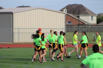 The green team moves down field. Their offense dominated, marching down the field quickly.