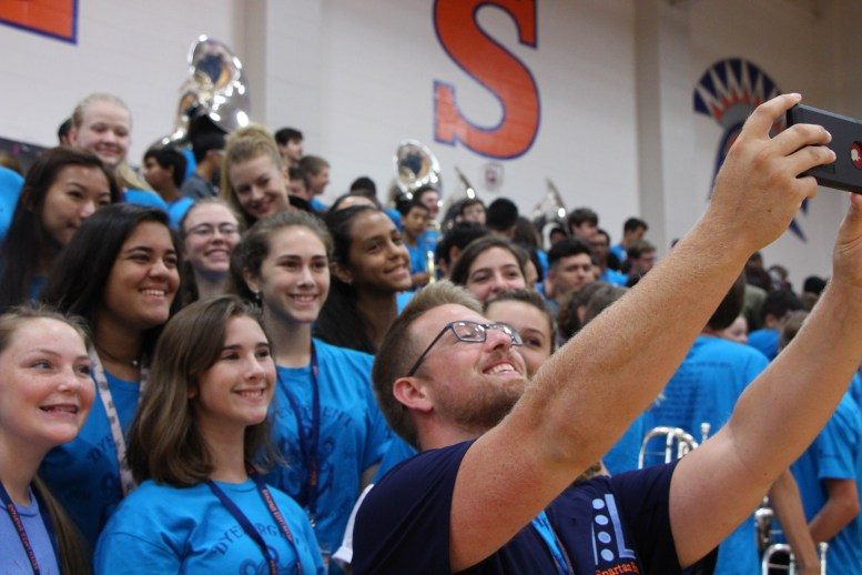 Color Guard smiles for a selfie before the pep rally.