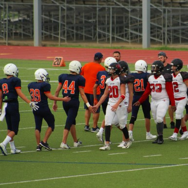 Sophomore Logan Johnson, juniors Ryan Ceana, Tucker Tate, Mitchell Slater and sophomore Connor Brooks high five the Fort Bend Austin players after the game. For all sports, good sportsmanship is an important character trait.