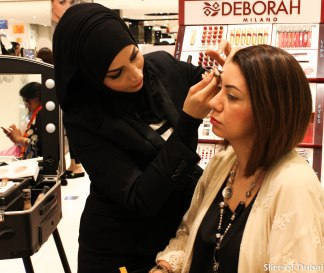 Maryam Ensan of Style Me Journal recieving a makeover at Lifestyle Beauty Festival